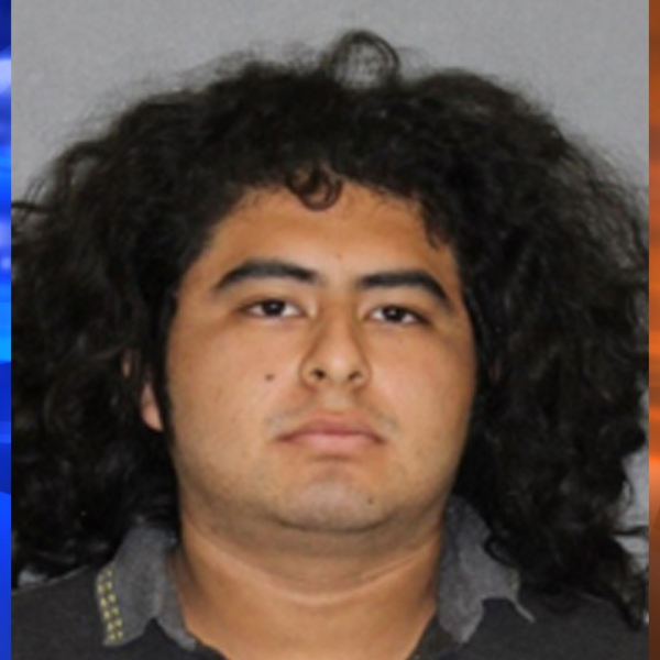 Angel Leonel Alonzo, 22, appears in a booking photo released by the Orange County District Attorney's Office on Sept. 20, 2019.