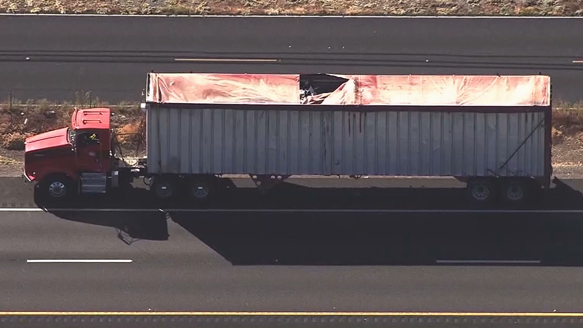 A skydiver was killed Thursday after landing on southbound Highway 99 in Northern California and being struck by a big rig, authorities said. (Credit: KCRA)