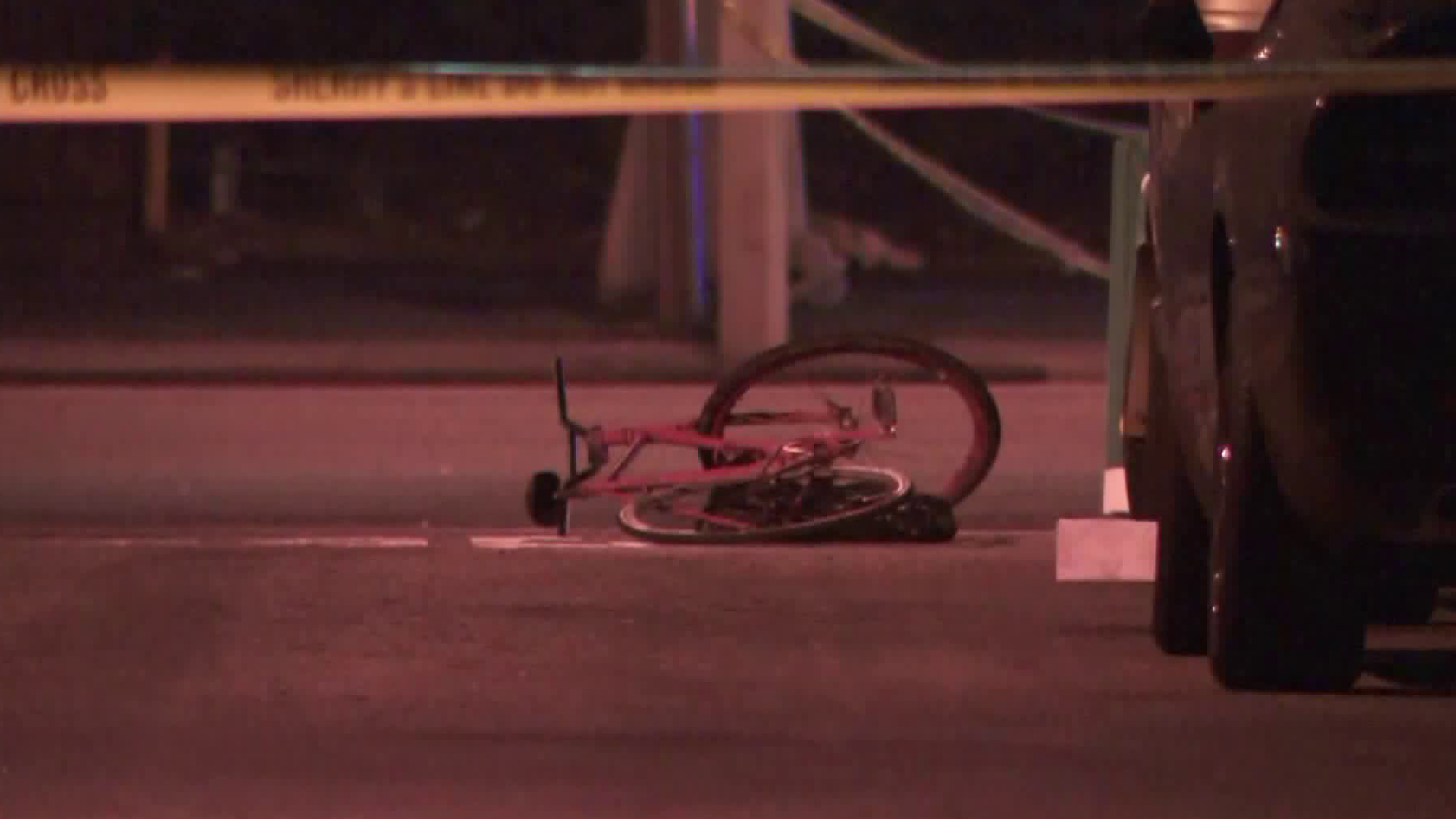 A bicycle is seen at the scene of a fatal shooting in the Florence-Firestone neighborhood on Sept. 15, 2019. (Credit: KTLA)