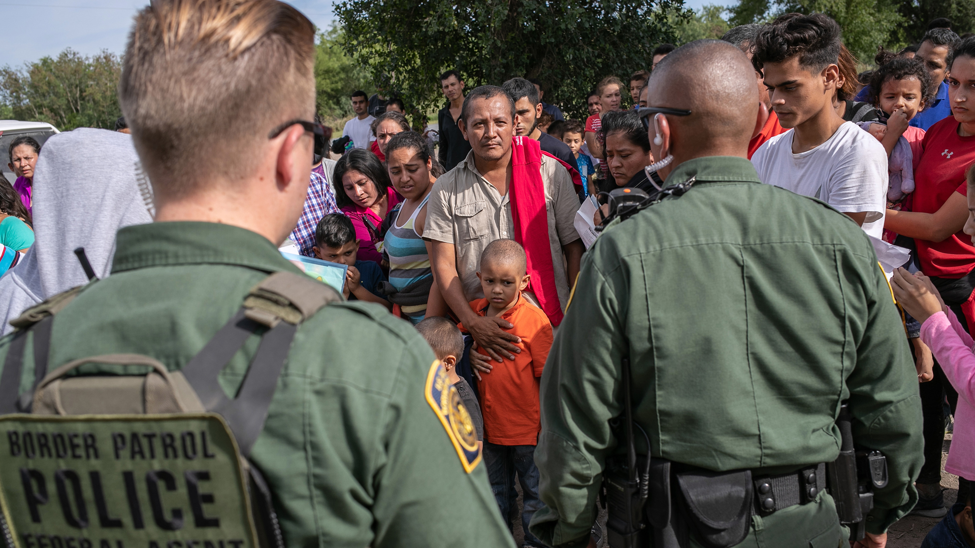 U.S. Border Patrol agents watch over immigrants after taking them into custody on July 02, 2019 in Los Ebanos, Texas. (Credit: John Moore/Getty Images)