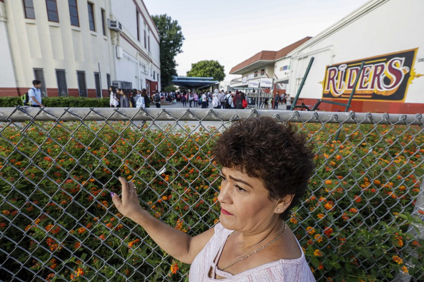 Felipa Martinez stands by the school fence to maker sure her daughter is safely inside the building on Sept. 11, 2019. (Credit: Irfan Khan/Los Angeles Times)