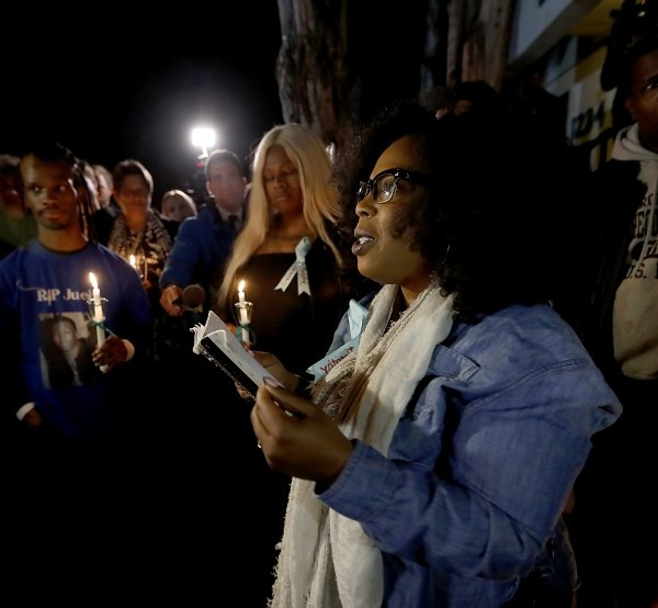 Activist Jasmyne Cannick joins members of West Hollywood's black and gay communities at a candlelight vigil outside the home of Ed Buck in January 2019. (Credit: Luis Sinco / Los Angeles Times)