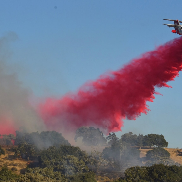An air tanker drops retardant on the McMurray Fire burning near Buellton on Sept. 9, 2019, in a photo released by Mike Eliason with the Santa Barbara County Fire Department.