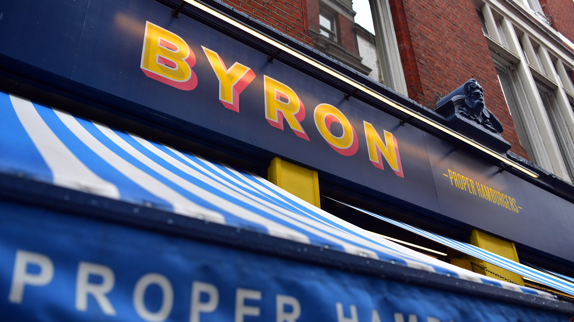 A Byron burger restaurant sign is pictured on August 2, 2016 in London, England.(Credit: Carl Court/Getty Images)