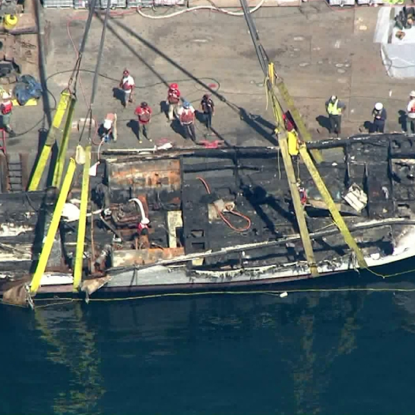 The Conception dive boat is raised more than a week after the fatal fire on Sept. 12, 2019. (Credit: KTLA)