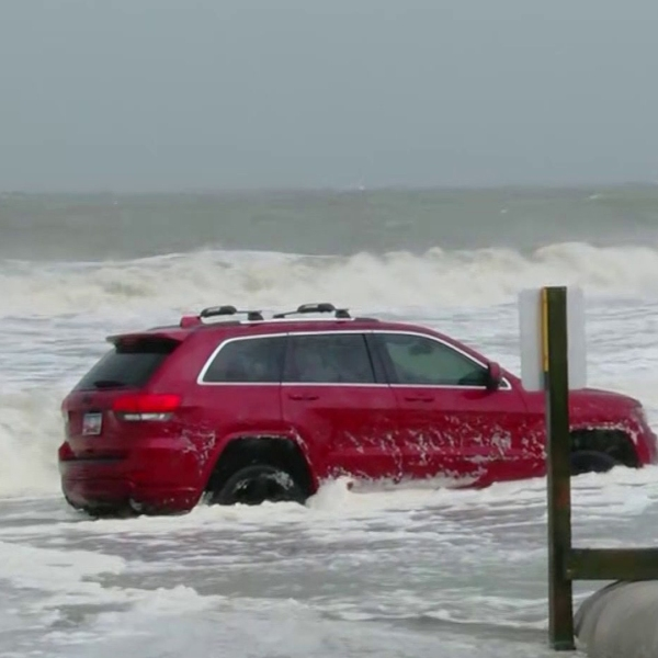 Someone tried driving on the beach in Myrtle Beach, South Carolina, during Hurricane Dorian. They were forced to abandon the vehicle. (Credit: WMBF)