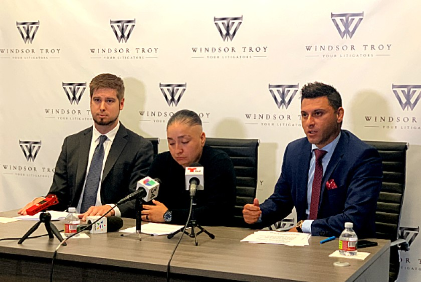 Valerie Arismendez, center, is flanked by attorneys Daniel Sharpe, left, and Shawn F. Matian at a news conference in Koreatown on Sept. 26, 2019, announcing a suit against the Los Angeles County Sheriff's Department.(Credit: Windsor Troy law firm via Los Angeles Times)