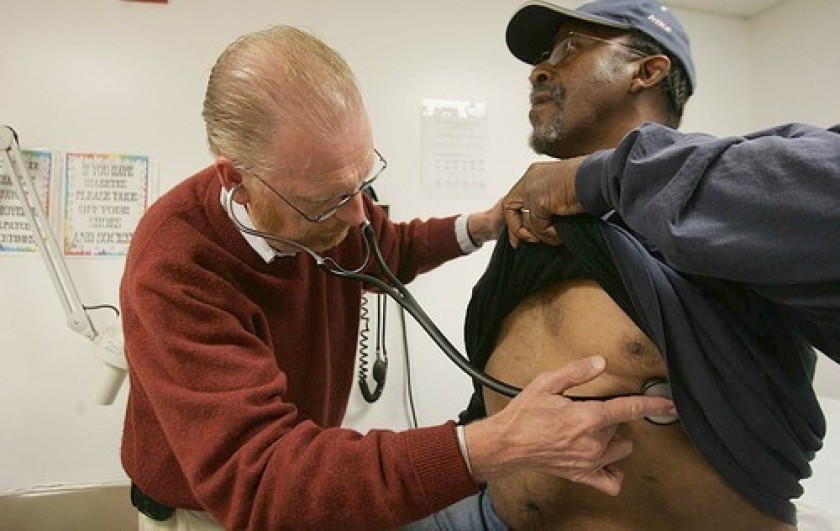 Dennis Bleakley examines Edward Sankey, 55, at the JWCH Medical Clinic in Los Angeles in this undated photo. (Credit: Francine Orr / Los Angeles Times)