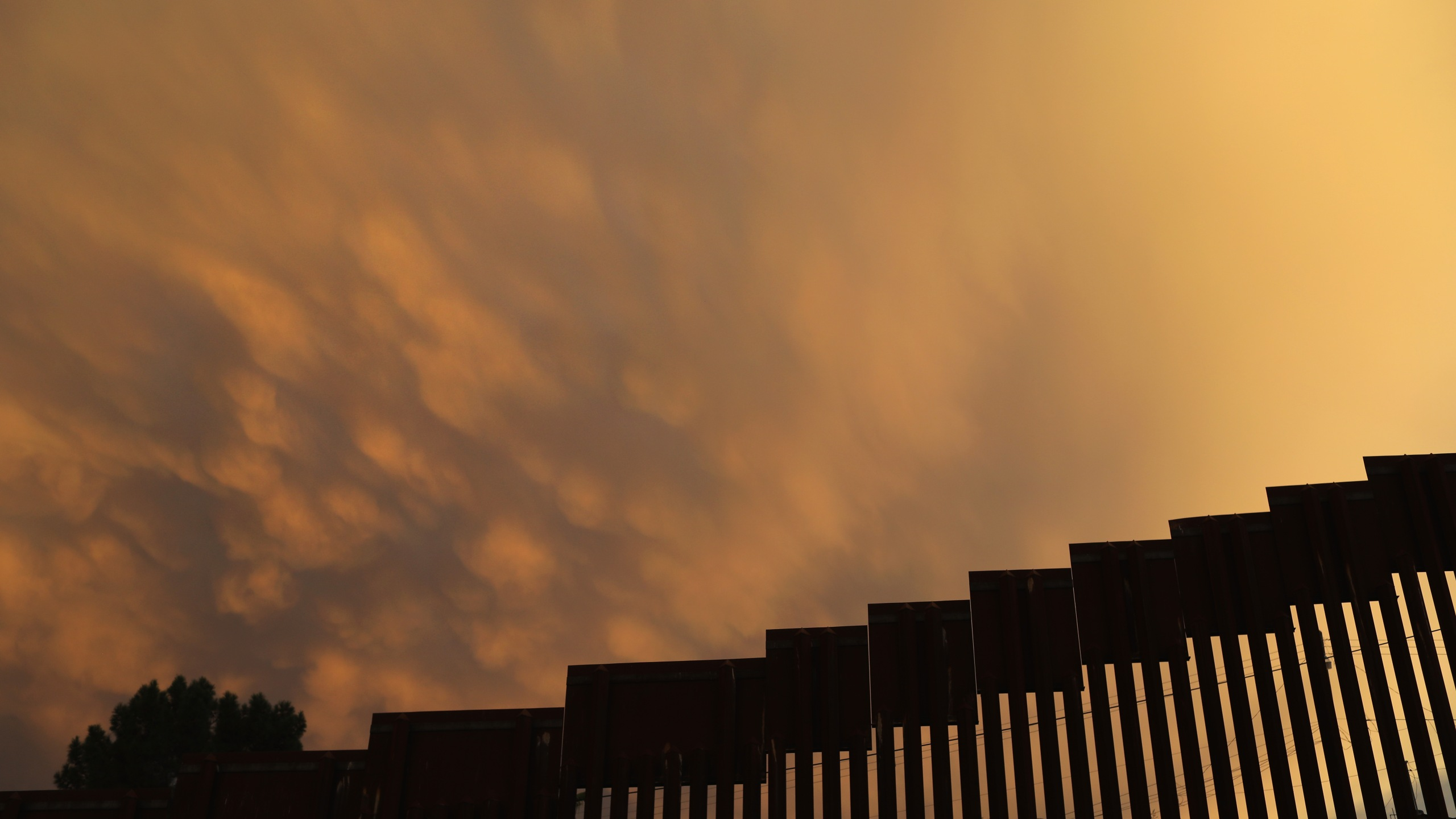 The U.S.-Mexico border fence is seen at sunset on July 22, 2018 in Nogales, Arizona. (Credit: John Moore/Getty Images)