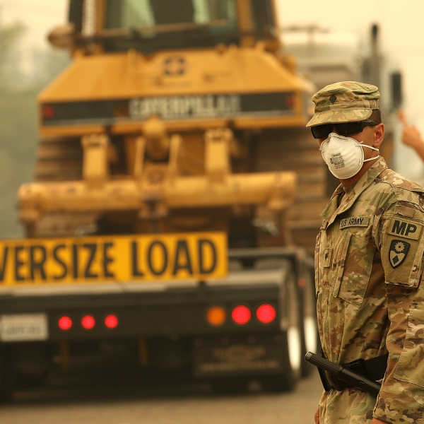A member of the California National Guard mans a checkpoint in an evacuated area as the Carr Fire moves through the Redding area on July 28, 2018. (Credit: Justin Sullivan / Getty Images)