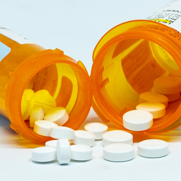 Pills spill out of two prescription bottles. (Getty Images)