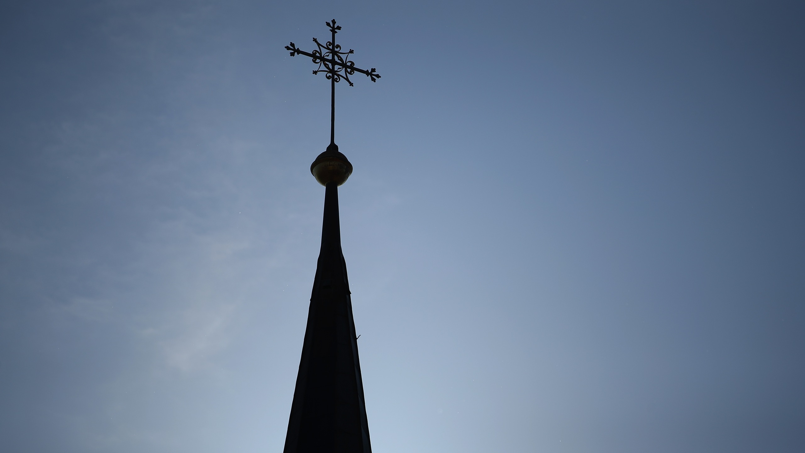 A cross stands on the spire of a Catholic church on Sept. 21, 2018 in Wallerdorf, Germany. (Credit: Sean Gallup/Getty Images)
