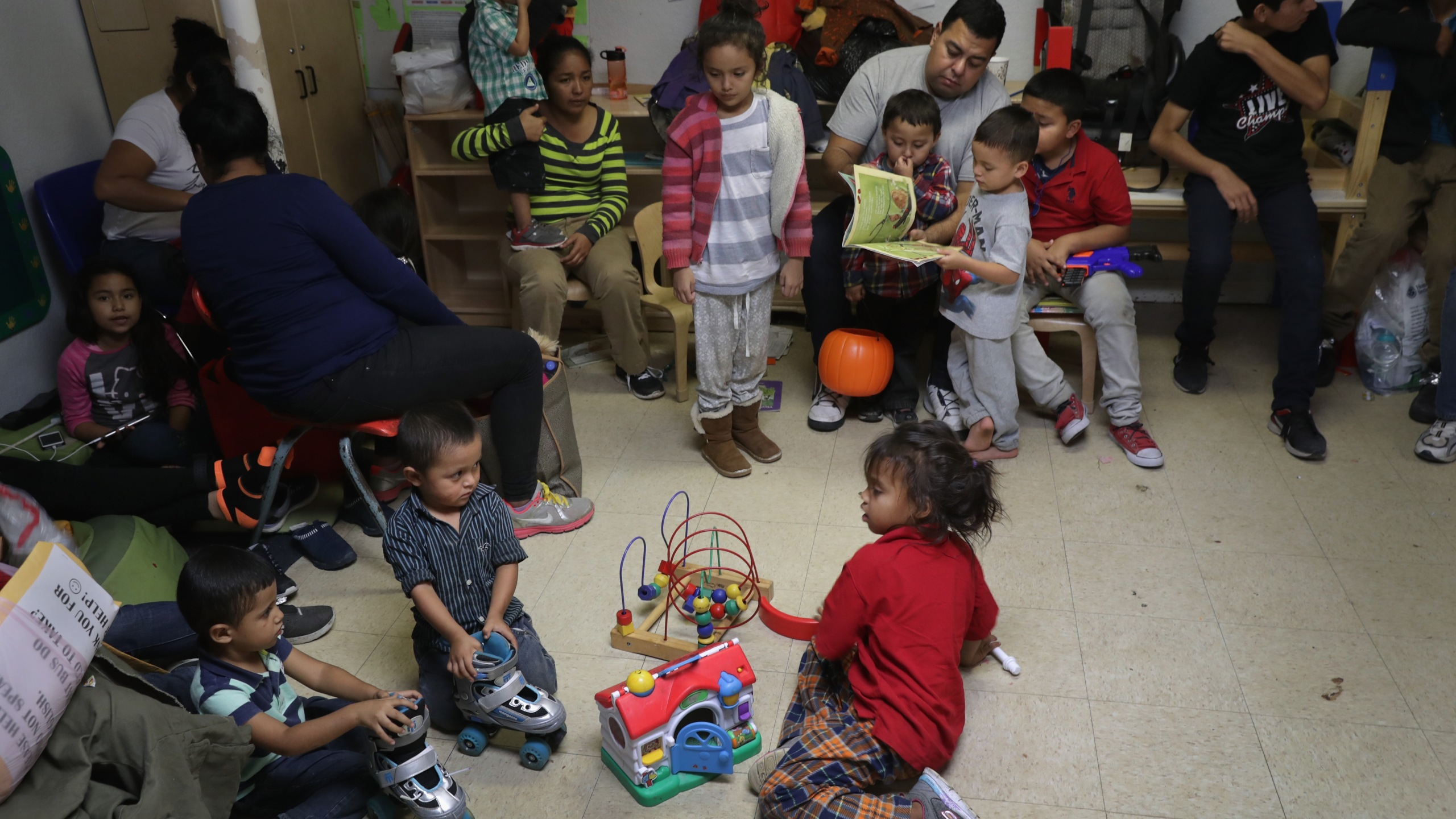 Migrant children read and play at an aid center after being released from U.S. government detention on Nov. 3, 2018 in McAllen, Texas.(Credit: John Moore/Getty Images)