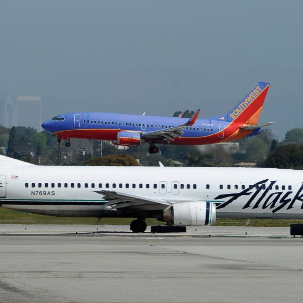 Southwest Airlines and Alaska Airlines planes are seen at the Los Angeles International Airport in this file photo. (Credit: Kevork Djansezian/Getty Images)