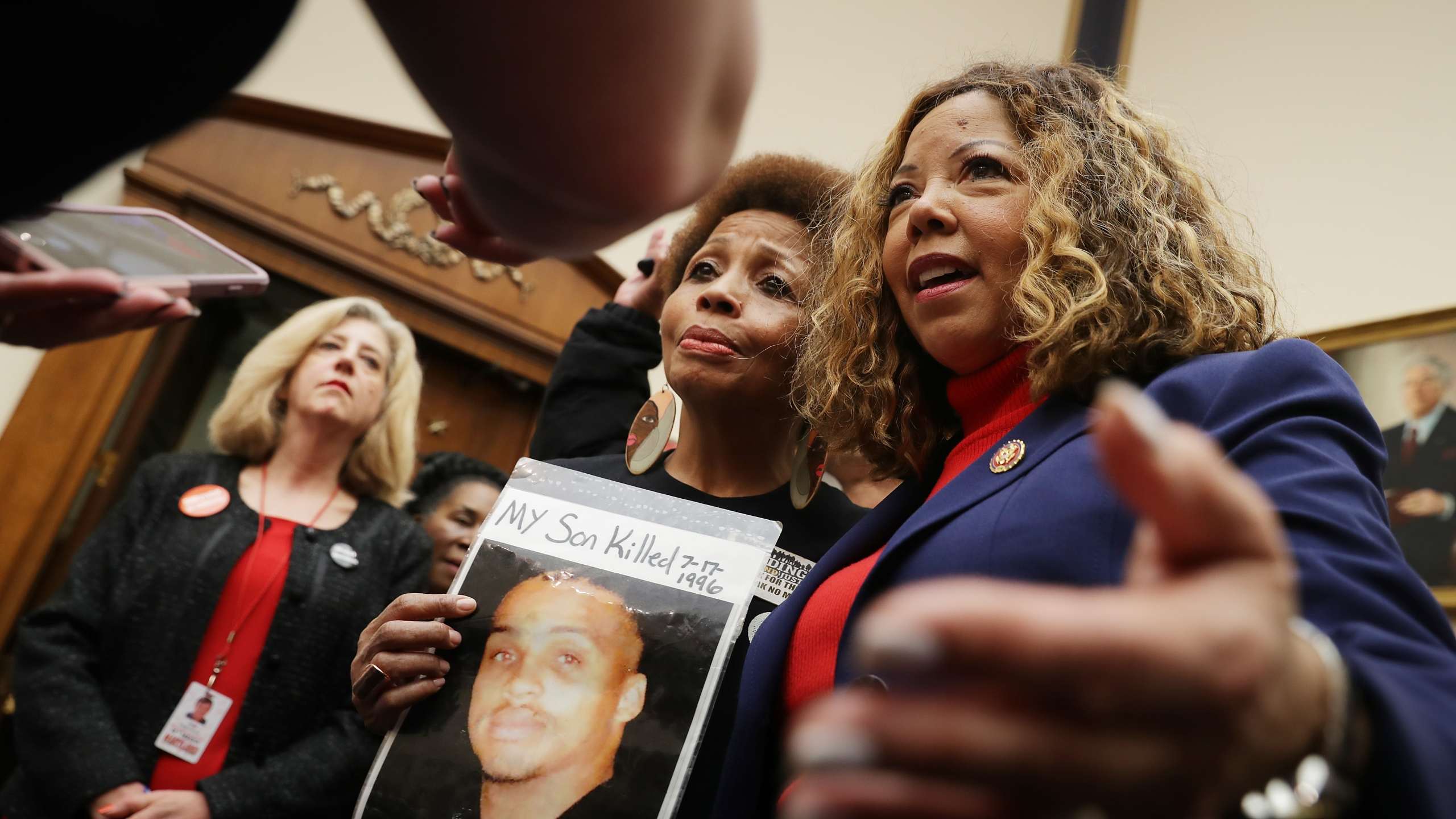The Brady Campaign's Mattie Scott (C) and Rep. Lucy McBath (D-GA), both of who lost sons to gun violence, pose for photographs before a hearing on gun violence legislation in the Rayburn House Office Building on Capitol Hill February 06, 2019 in Washington, DC. (Credit: Chip Somodevilla/Getty Images)
