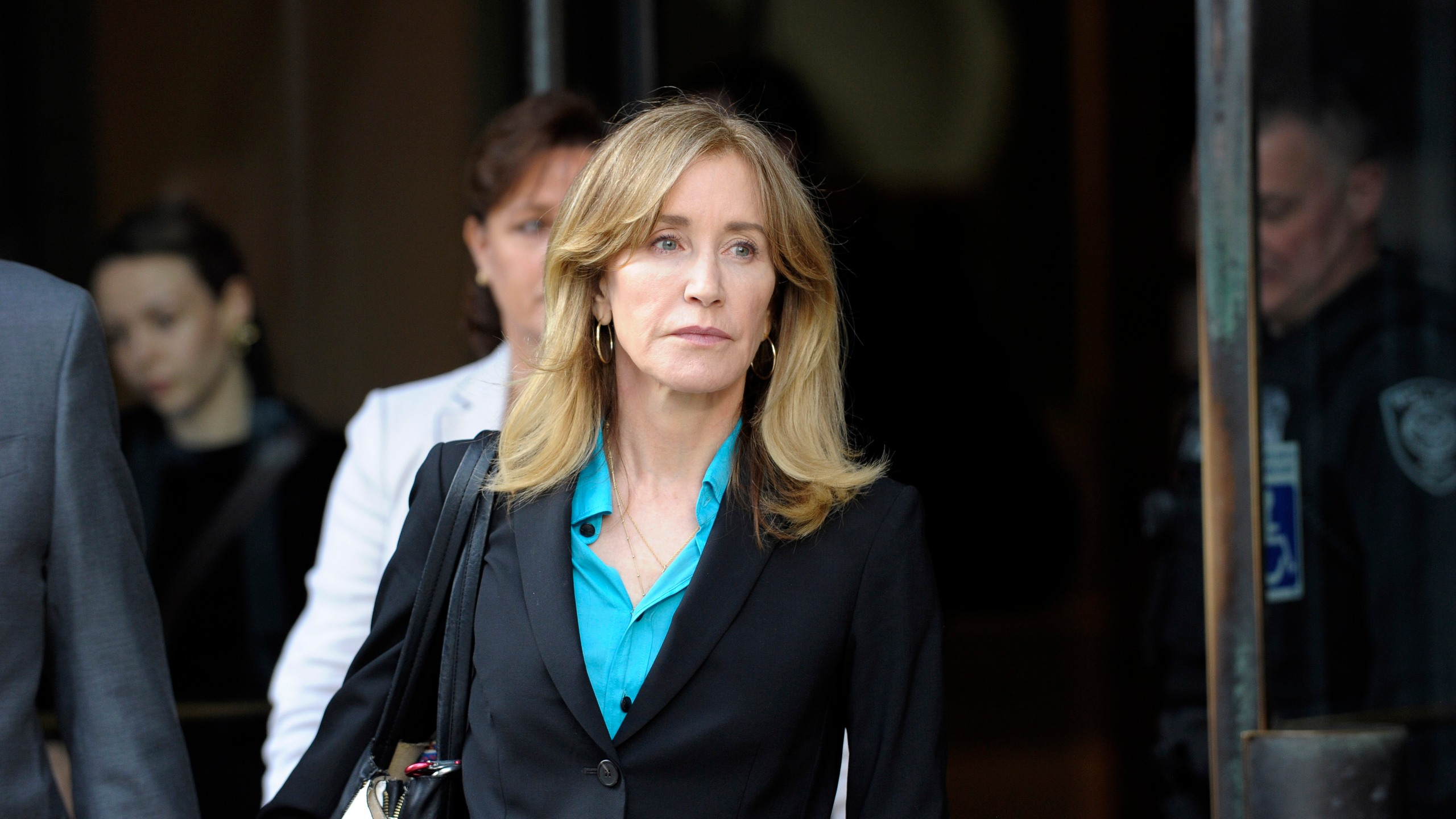 Actress Felicity Huffman exits the courthouse in Boston after facing charges for allegedly conspiring to commit mail fraud and other charges in the college admissions scandal on April 3, 2019. (Credit: Joseph Prezioso / AFP / Getty Images)
