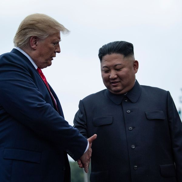 U.S. President Donald Trump and North Korea's leader Kim Jong-un shake hands before a meeting in the Demilitarized Zone (DMZ) on June 30, 2019. (Credit: BRENDAN SMIALOWSKI/AFP/Getty Images)