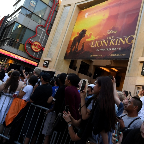 "Fans wait outside the Dolby theatre as guests arrive for the world premiere of Disney's ""The Lion King"" on July 9, 2019, in Hollywood. (Credit: Robyn Beck/AFP/Getty Images)"