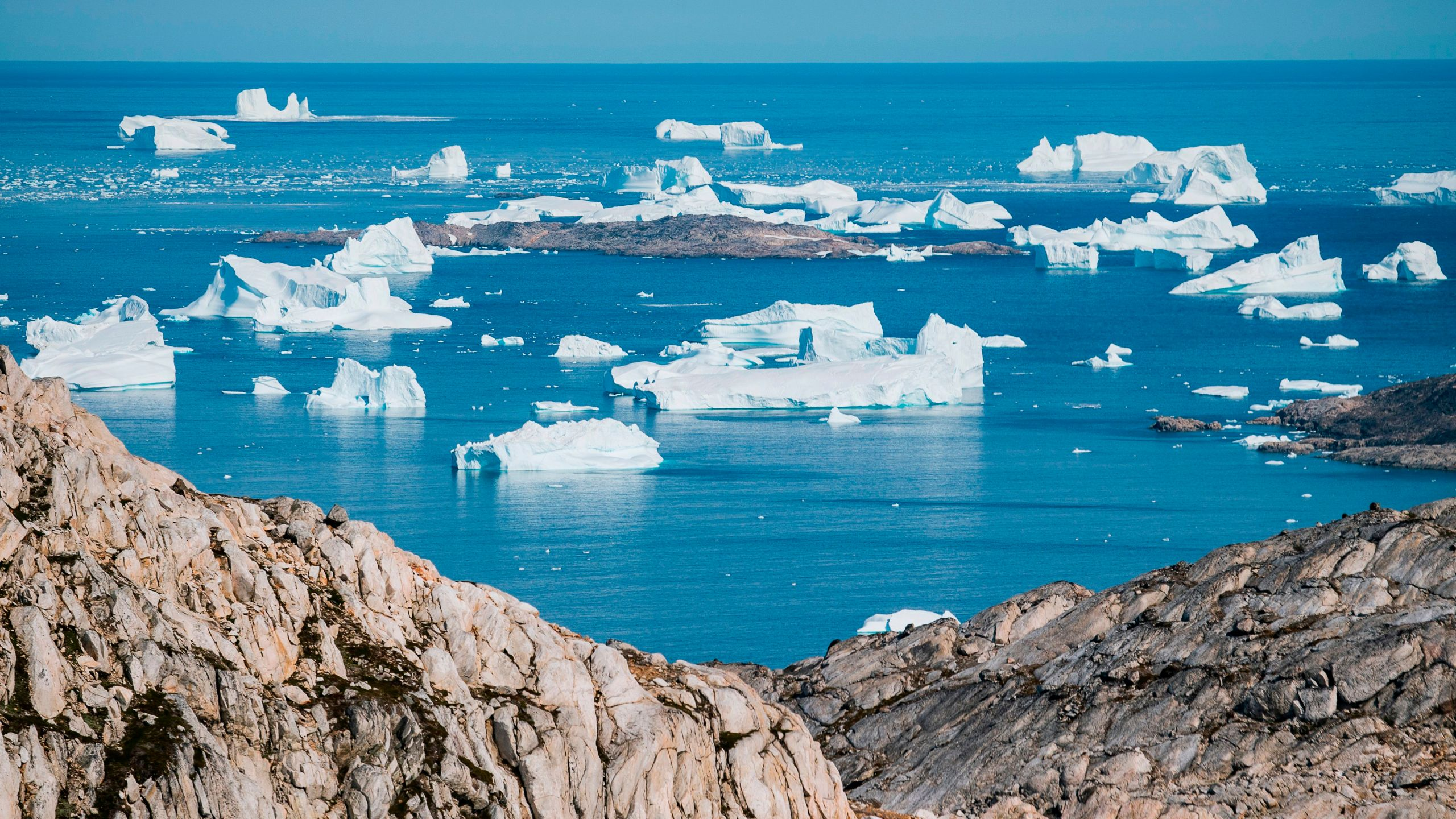 An aerial photo taken on August 15, 2019 shows icebergs as they float along the eastern cost of Greenland near Kulusuk. (Credit: JONATHAN NACKSTRAND/AFP/Getty Images)