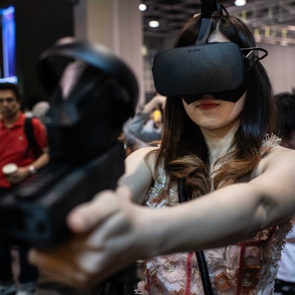 A woman plays a virtual reality game during the E-Sports and Music Festival Hong Kong 2019 on July 28, 2019, in Hong Kong, China. (Credit: Ivan Abreu/Getty Images for Hong Kong Tourism Board)