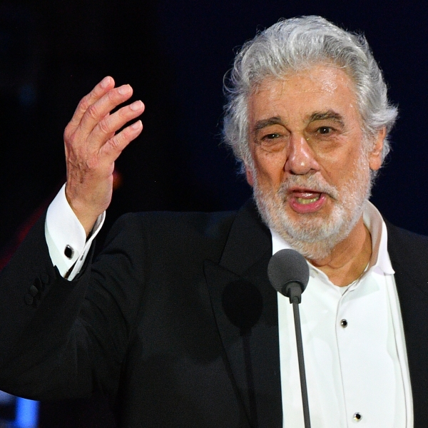 Spanish tenor Placido Domingo gestures as he performs during his concert in Szeged, southern Hungary, on Aug. 28, 2019. (Credit: Attila Kisbenedek / AFP / Getty Images)