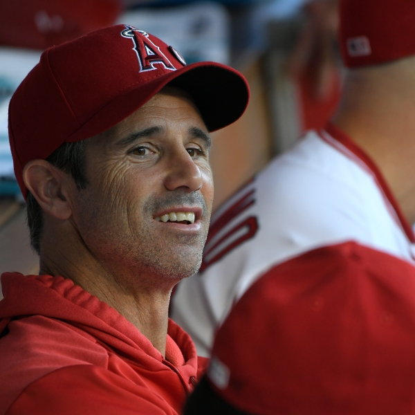 Brad Ausmus of the Los Angeles Angels looks on from the dugout in a game against the Boston Red Sox at Angel Stadium of Anaheim on Aug. 30, 2019. (Credit: John McCoy/Getty Images)