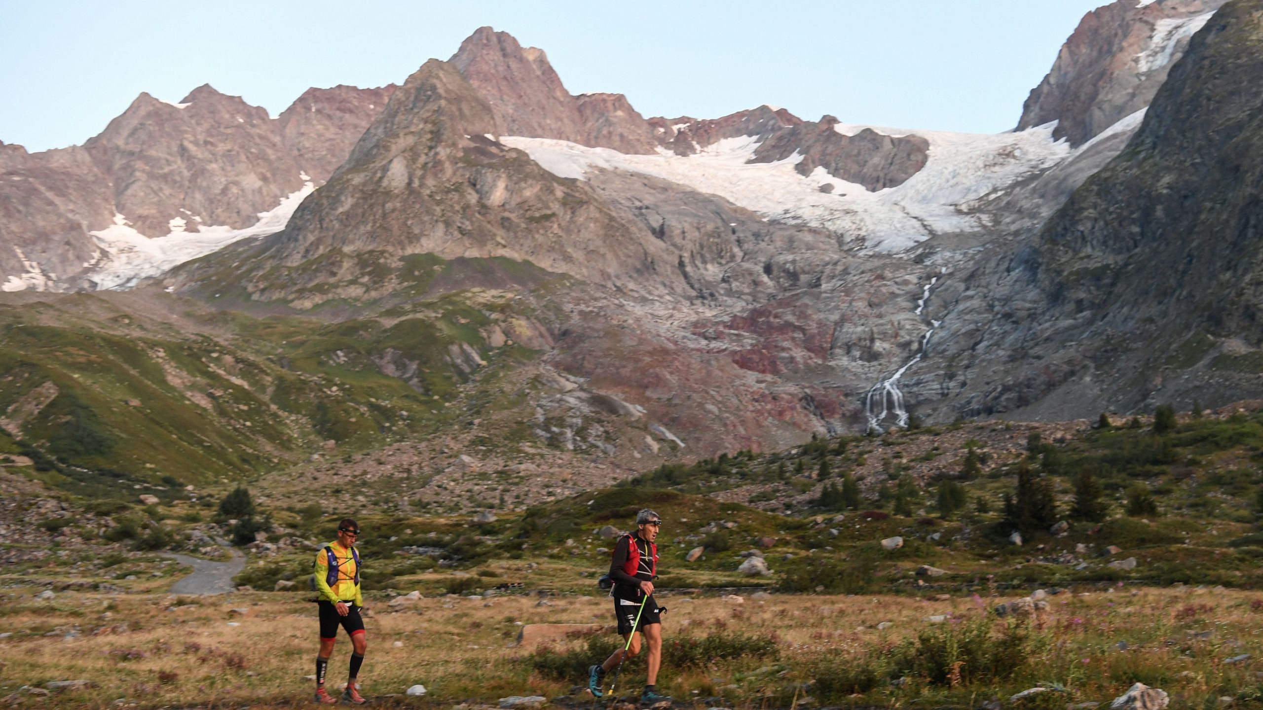 Competitors perform during the 170 km Mount Blanc Ultra Trail (UTMB) race around the Mont-Blanc, crossing France, Italy and Switzerland, on Aug. 31, 2019, in Lac de Combal, Courmayeur, Italy. (Credit: JEAN-PIERRE CLATOT/AFP/Getty Images)