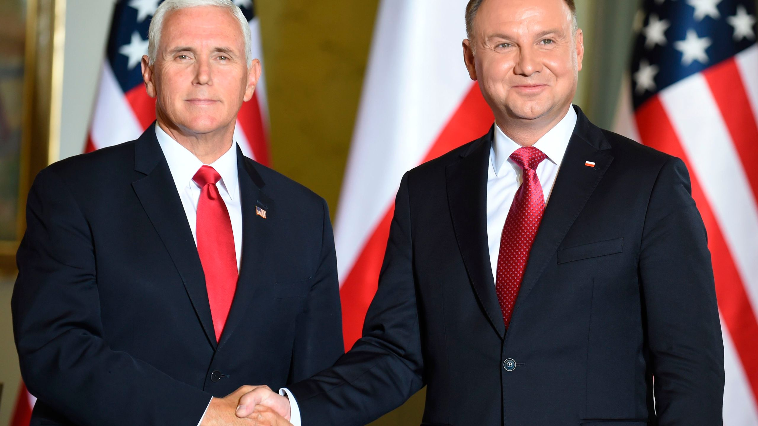 Polish President Andrzej Duda (right) shakes hand with U.S. Vice President Mike Pence during a meeting in Warsaw on Sept. 2, 2019. (Credit: JANEK SKARZYNSKI/AFP/Getty Images)