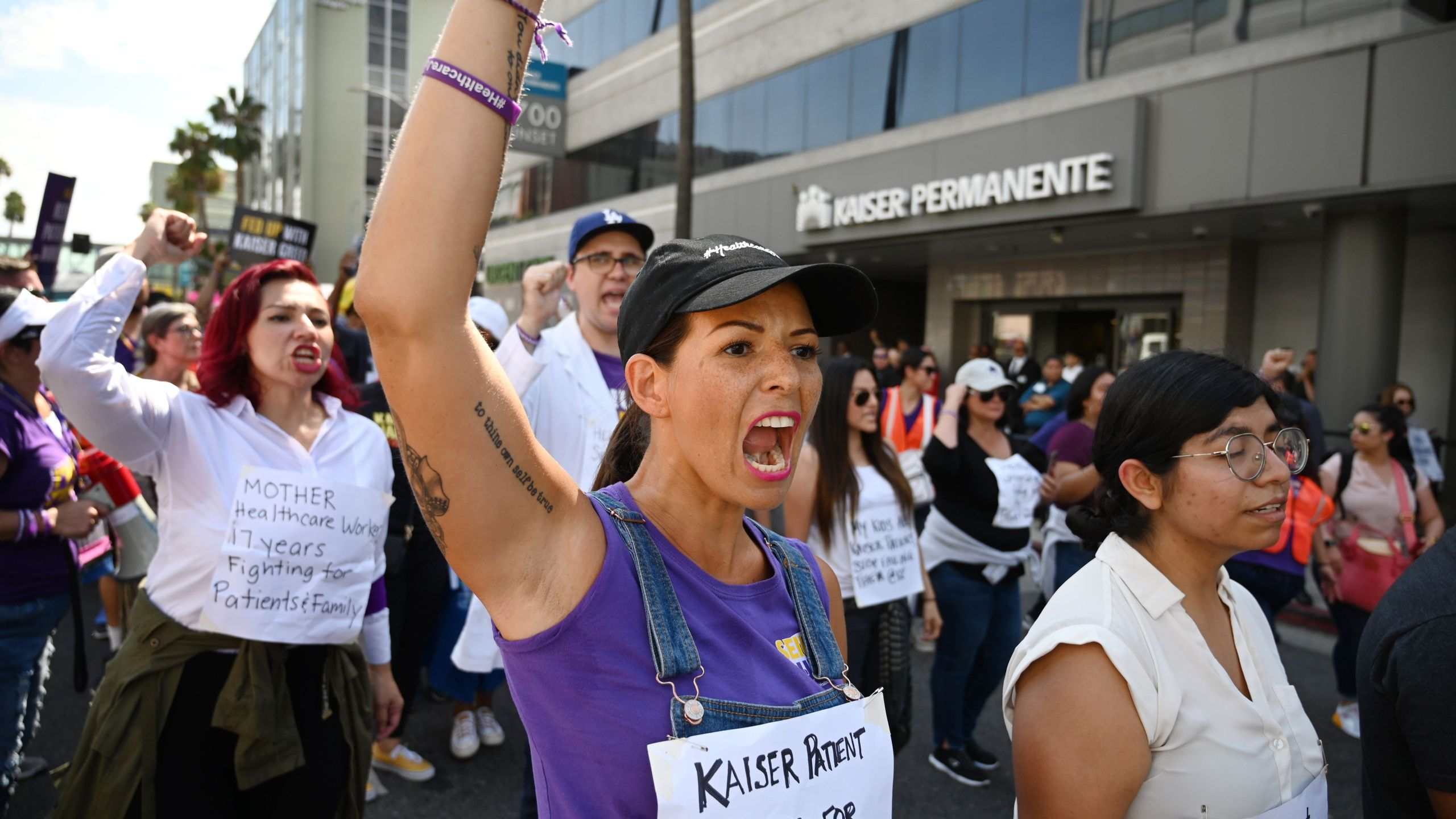 Kaiser Permanente health care workers, patients and their supporters march in a Labor Day protest in Los Angeles on Sept. 2, 2019. (Credit: Robyn Beck / AFP / Getty Images)