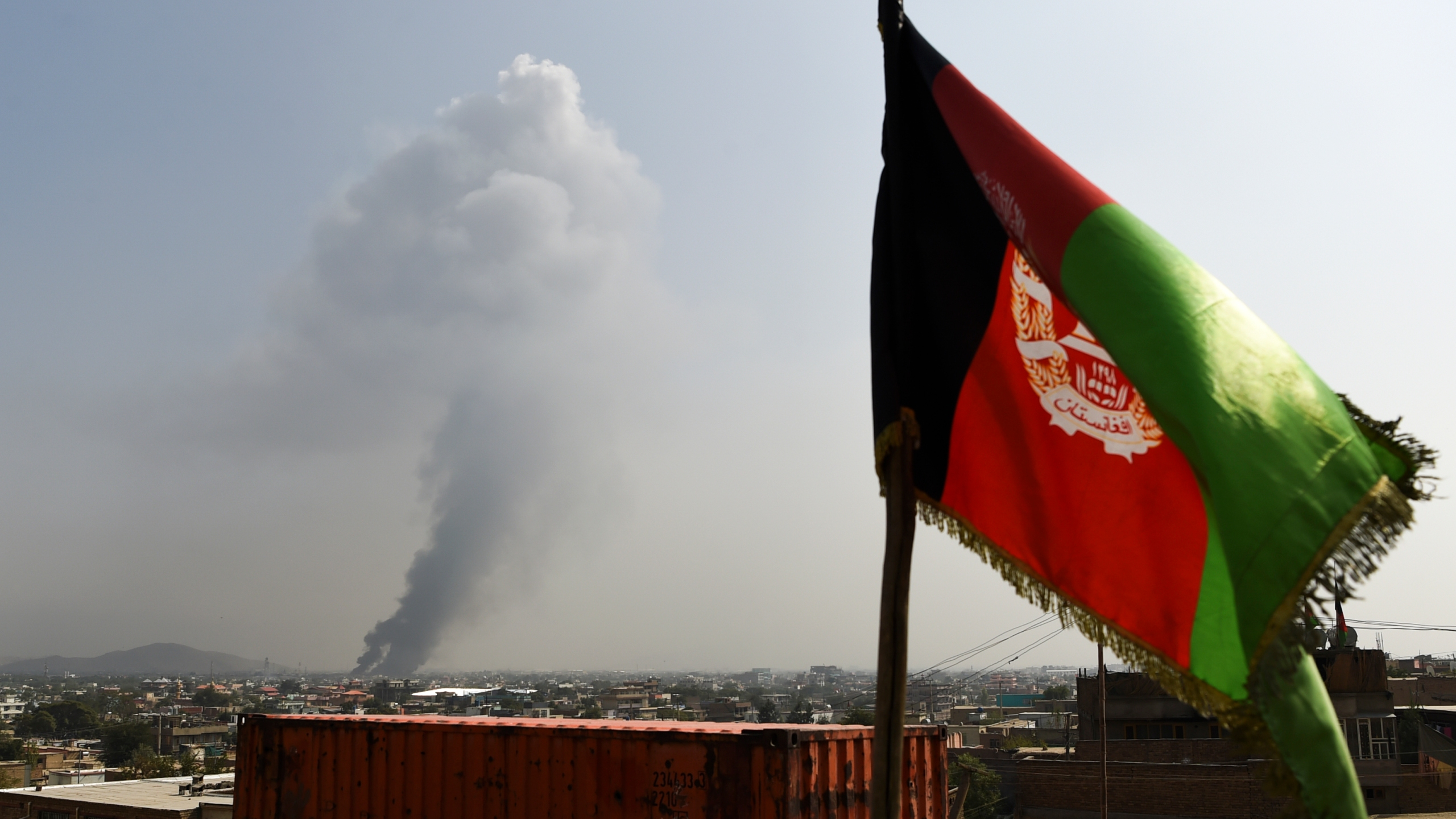 Smoke rises from the site of an attack after a massive explosion the night before near the Green Village in Kabul on Sept. 3, 2019. (Credit: WAKIL KOHSAR/AFP/Getty Images)