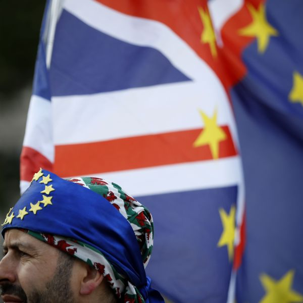 An activist wears a bandana of EU colors at a cross-party rally organized by the People's Vote organization campaigning for a second EU referendum, outside the Houses of Parliament in central London, on Sept. 4, 2019. (Credit: Tolga Akmen / AFP / Getty Images)