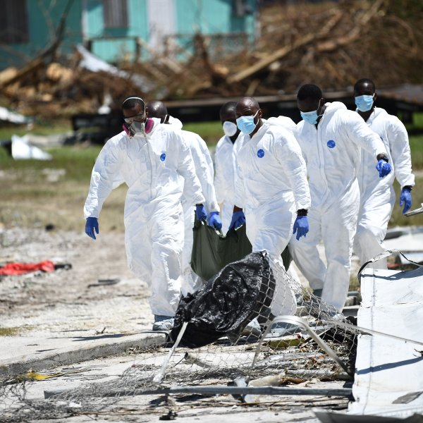 Rescue workers recover the body of a victim of Hurricane Dorian on September 5, 2019, in Marsh Harbour, Great Abaco Island in the Bahamas. (Credit: BRENDAN SMIALOWSKI/AFP/Getty Images)