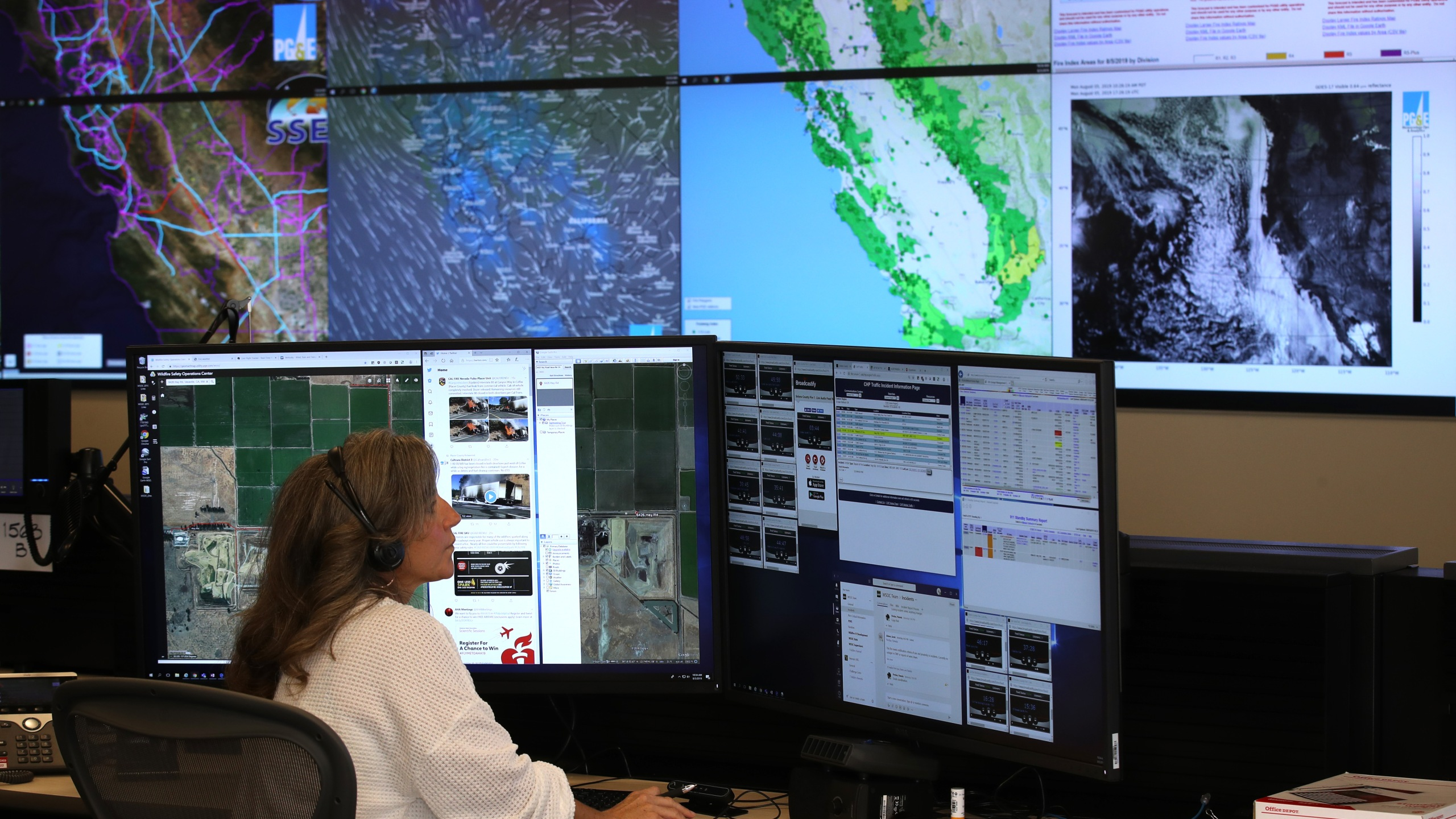 Pacific Gas and Electric Senior Wildfire Operations Center Analyst Sarah Gibson monitors weather and satellite images of fire areas at the PG&E Wildfire Safety Operations Center on Aug. 5, 2019, in San Francisco. (Credit: Justin Sullivan/Getty Images)