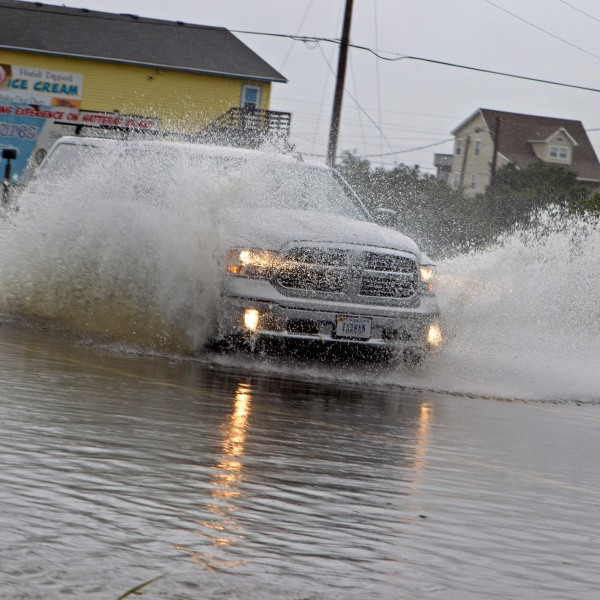 A truck speeds on a flooded street in Rodanthe as Hurricane Dorian hits Cape Hatteras in North Carolina on Sep. 6, 2019. (Credit: Jose LuisMagana /AFP/Getty Images)
