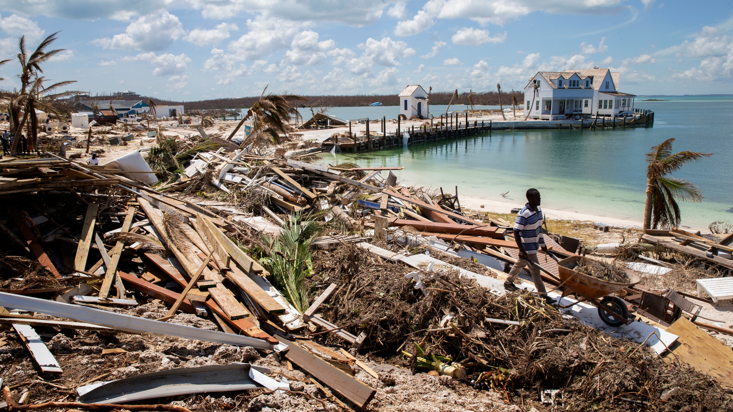 Workers clean debris at the Abaco Inn in Hurricane Dorian-devastated Elbow Key Island on Sept. 7, 2019 the Bahamas. (Credit: Jose Jimenez/Getty Images)