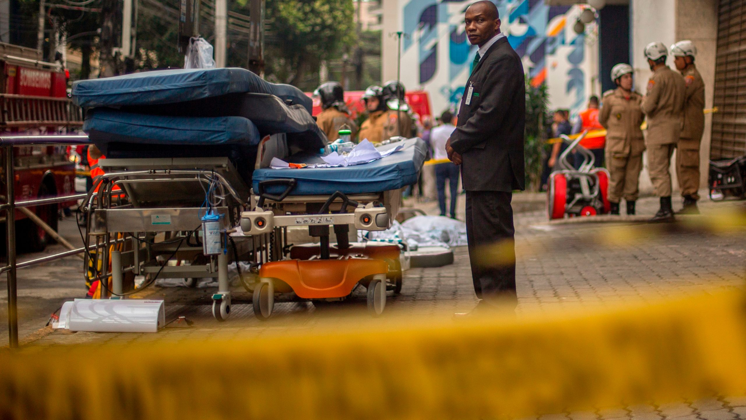 A security officer looks after medical equipment left outside Badim Hospital following a fire at the medical facility in the Tijuca neighborhood, Rio de Janeiro, Brazil, on Sept. 13, 2019. (Credit: MAURO PIMENTEL/AFP/Getty Images)