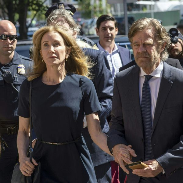 Actress Felicity Huffman, escorted by her husband William H. Macy, makes her way to the entrance of the John Joseph Moakley United States Courthouse in Boston on Sept. 13, 2019. (Credit: JOSEPH PREZIOSO/AFP/Getty Images)