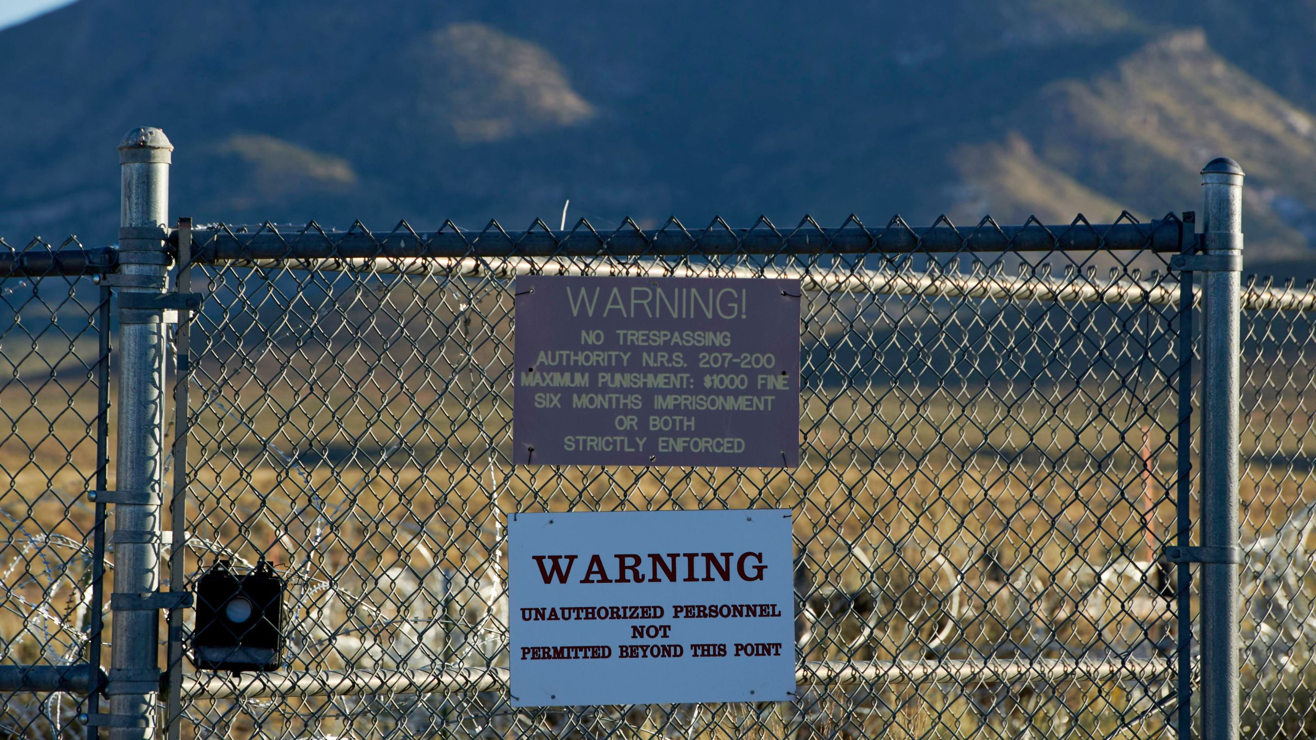 Signage is posted outside a gate of the Nevada Test and Training Range, commonly referred to as Area 51, near Rachel, Nevada, on September 13, 2019. (Credit: BRIDGET BENNETT/AFP/Getty Images)