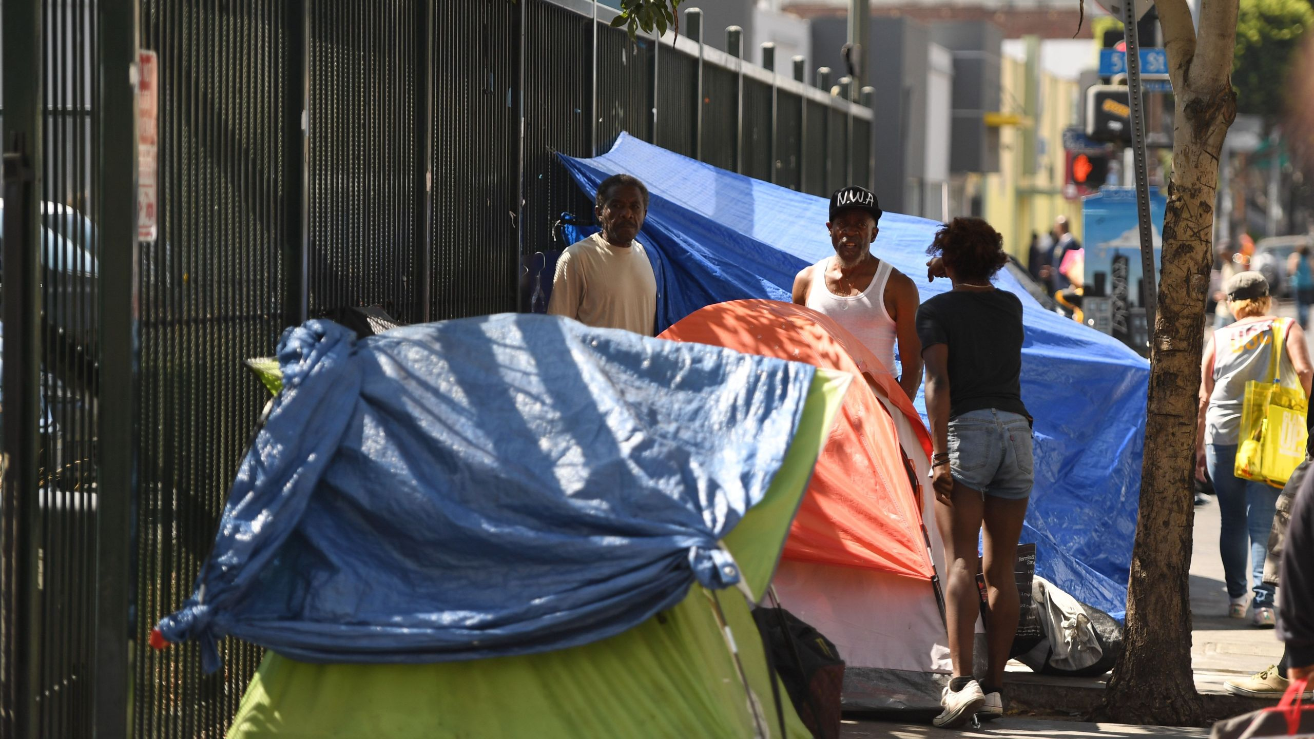 Tents line the street in Skid Row in Los Angeles on Sept. 17, 2019. (Credit: Robyn Beck / AFP / Getty Images)