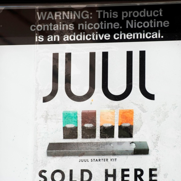 A sign advertises Juul vaping products in Los Angeles, California, September 17, 2019. (Credit: ROBYN BECK/AFP/Getty Images)