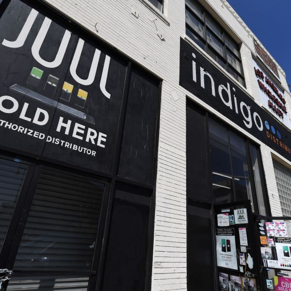 A sign advertises Juul vaping products in Los Angeles on Sept. 17, 2019. (Credit: ROBYN BECK/AFP/Getty Images)