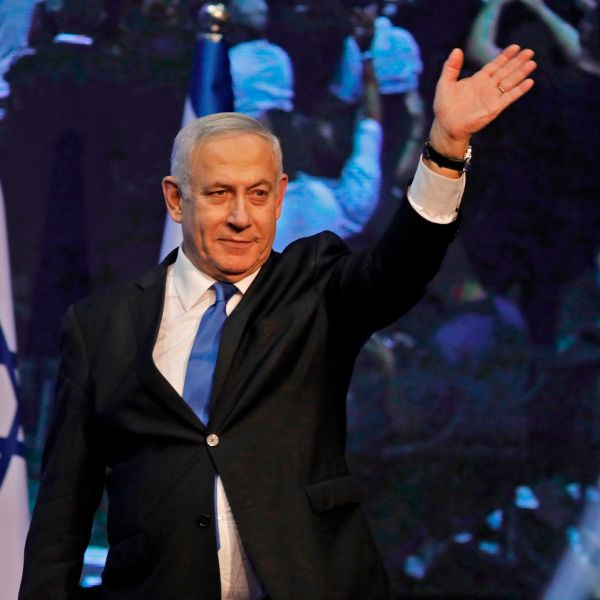 Israeli Prime Minister Benjamin Netanyahu waves to supporters upon arrival at his Likud party's electoral campaign headquarters to give an address early on Sept. 18, 2019. (Credit: Menahem Kahana / AFP / Getty Images)