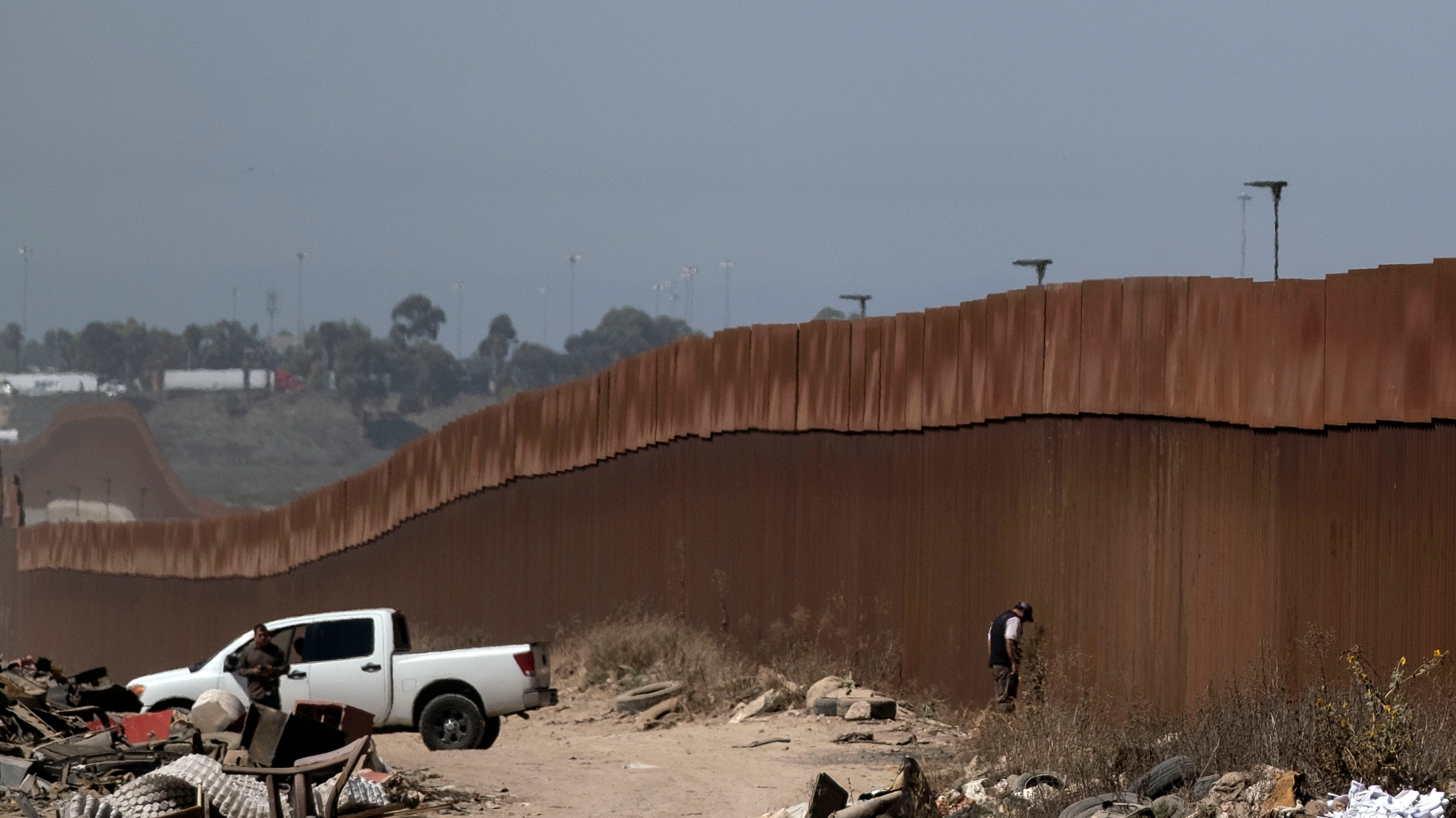 Mexican security forces patrol the U.S.-Mexico border fence in Tijuana Baja California state, Mexico, on Sept. 18, 2019, in preparation for U.S. President Donald Trump's visit to the border wall in Otay Mesa following a rally in San Diego. (Credit: GUILLERMO ARIAS/AFP/Getty Images)