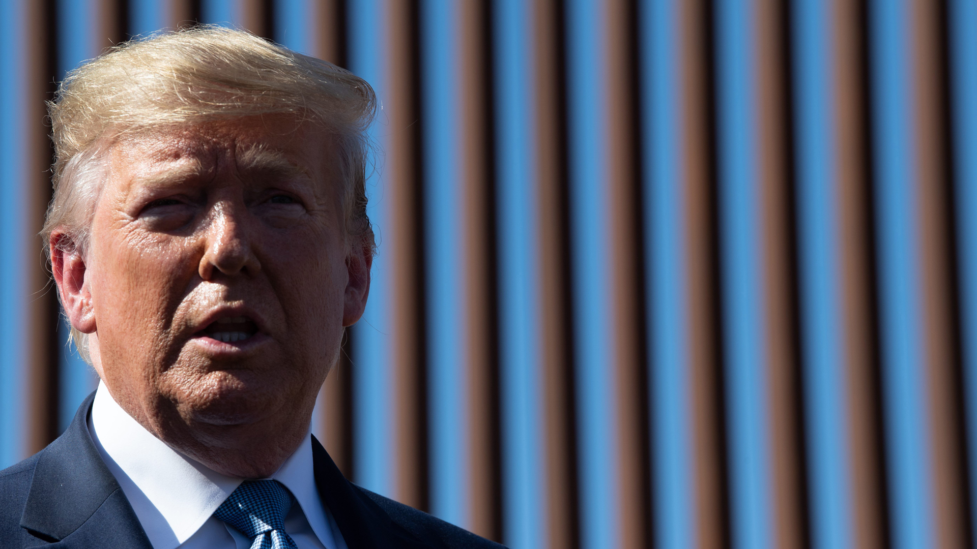Donald Trump visits the US-Mexico border fence in Otay Mesa, California on Sept. 18, 2019. (Nicholas Kamm/AFP/Getty Images)