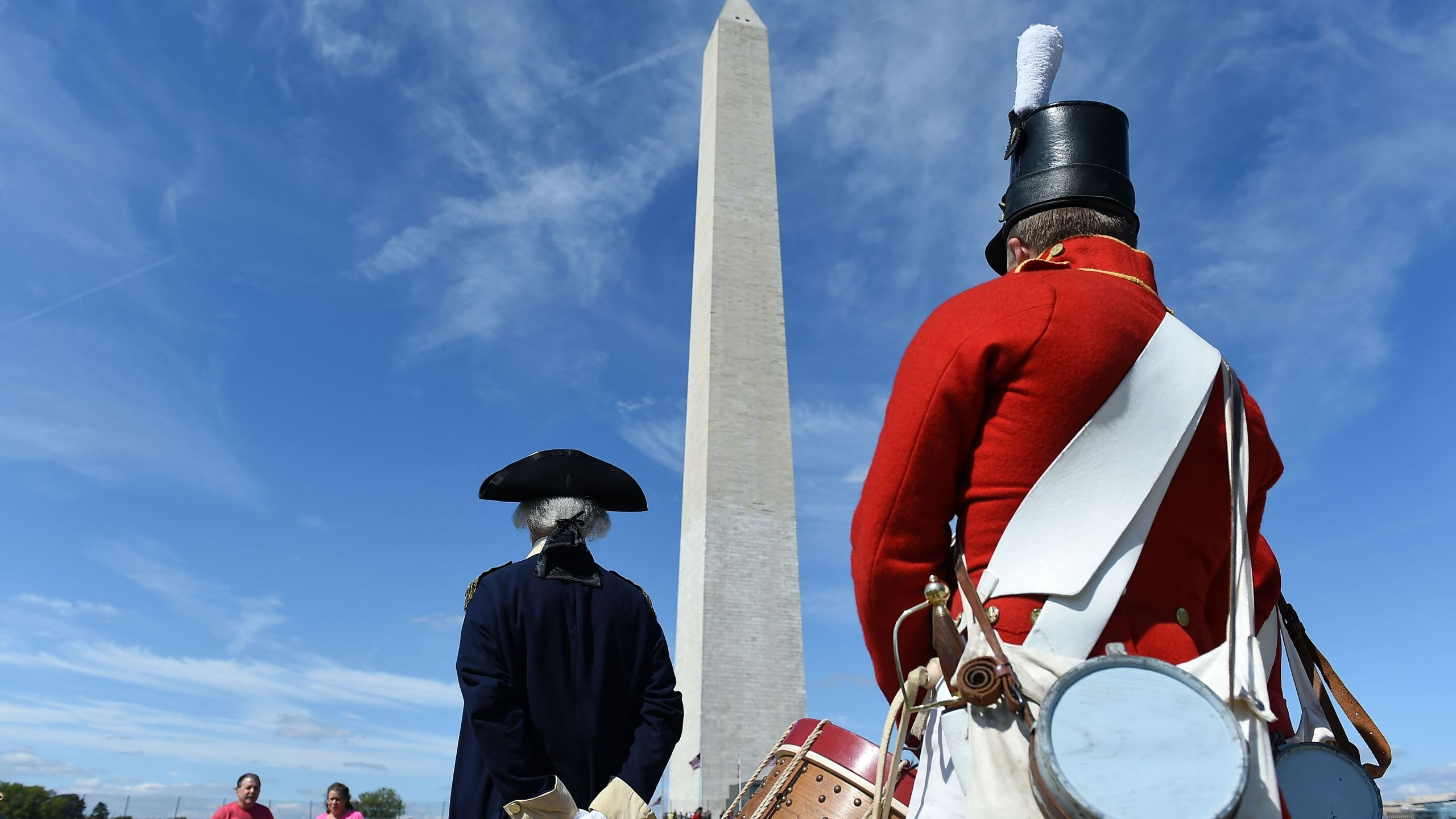 People dressed in historical costumes participate in the reopening of the Washington Monument on Sep. 19, 2019, in Washington, DC. (Credit: Olivier Douliery/AFP/Getty Images)
