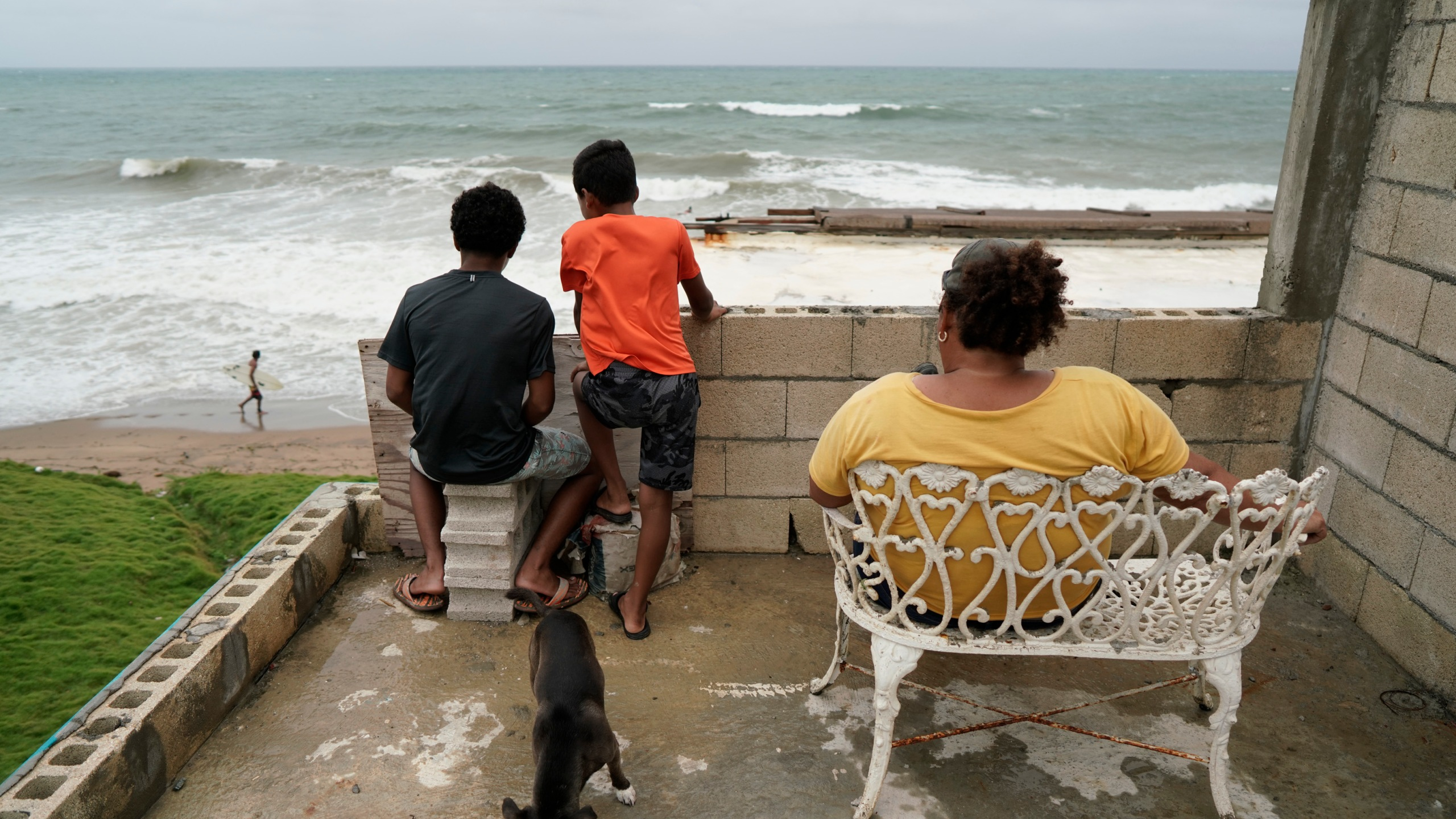 People look out to sea as Tropical Storm Karen approaches in Yabucoa, Puerto Rico, Sept. 24, 2019. (Credit: ERIC ROJAS/AFP/Getty Images)
