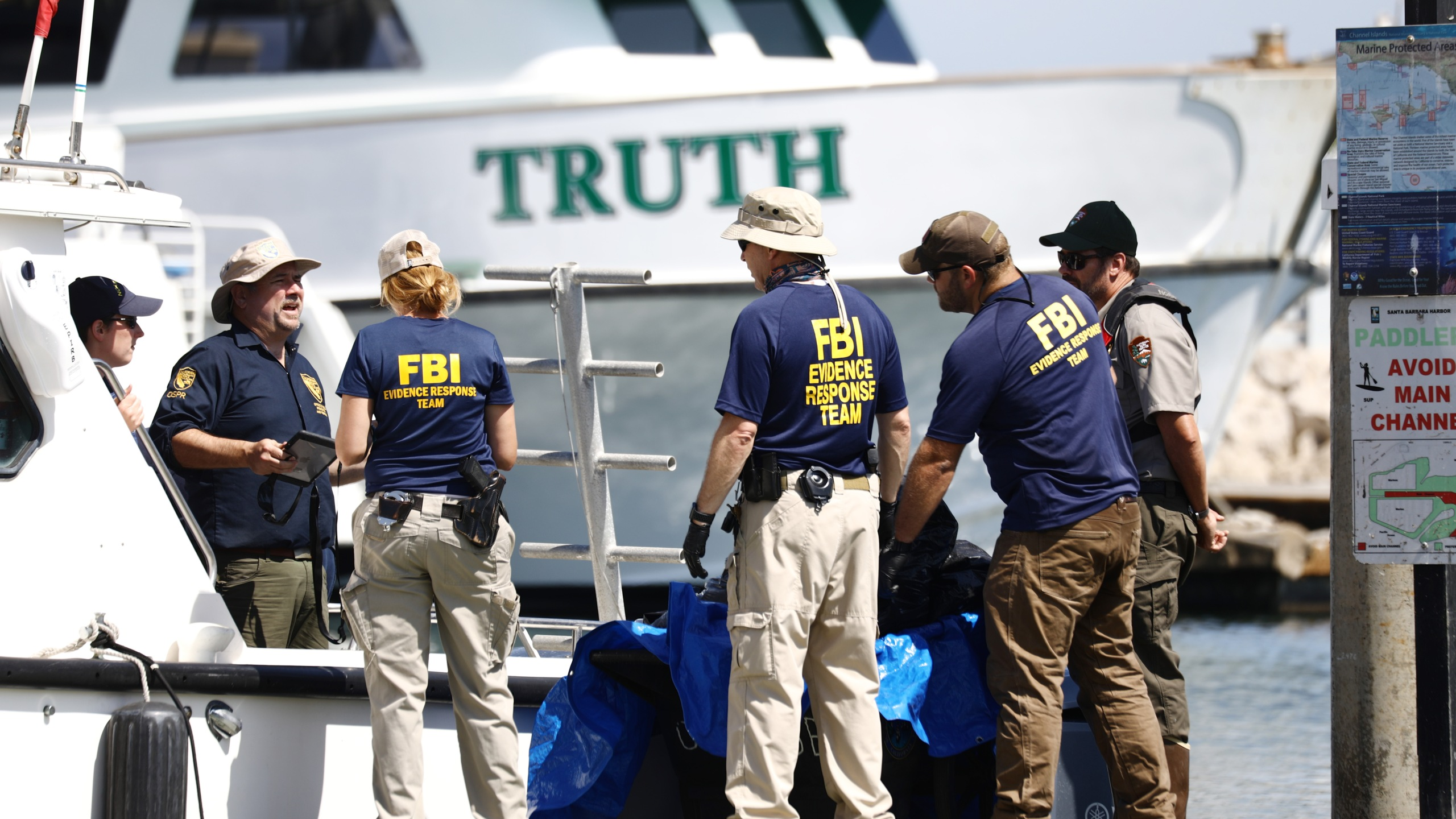 Members of the FBI Evidence Response Team and other officials work in front of the ship Truth, a sister ship of the diving ship Conception in Santa Barbara on Sept. 3, 2019. (Credit: Mario Tama/Getty Images)