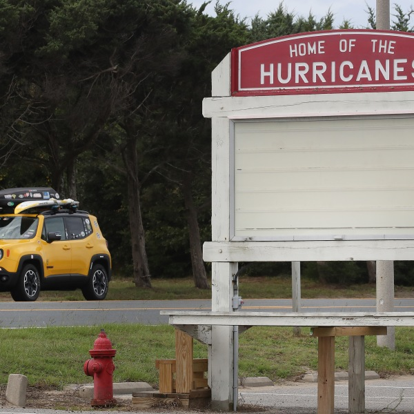 A vehicle drives past the Cape Hatteras Secondary School, an area under a mandatory evacuation due to approaching Hurricane Dorian on September 5, 2019 in Buxton, North Carolina. (Credit: Mark Wilson/Getty Images)