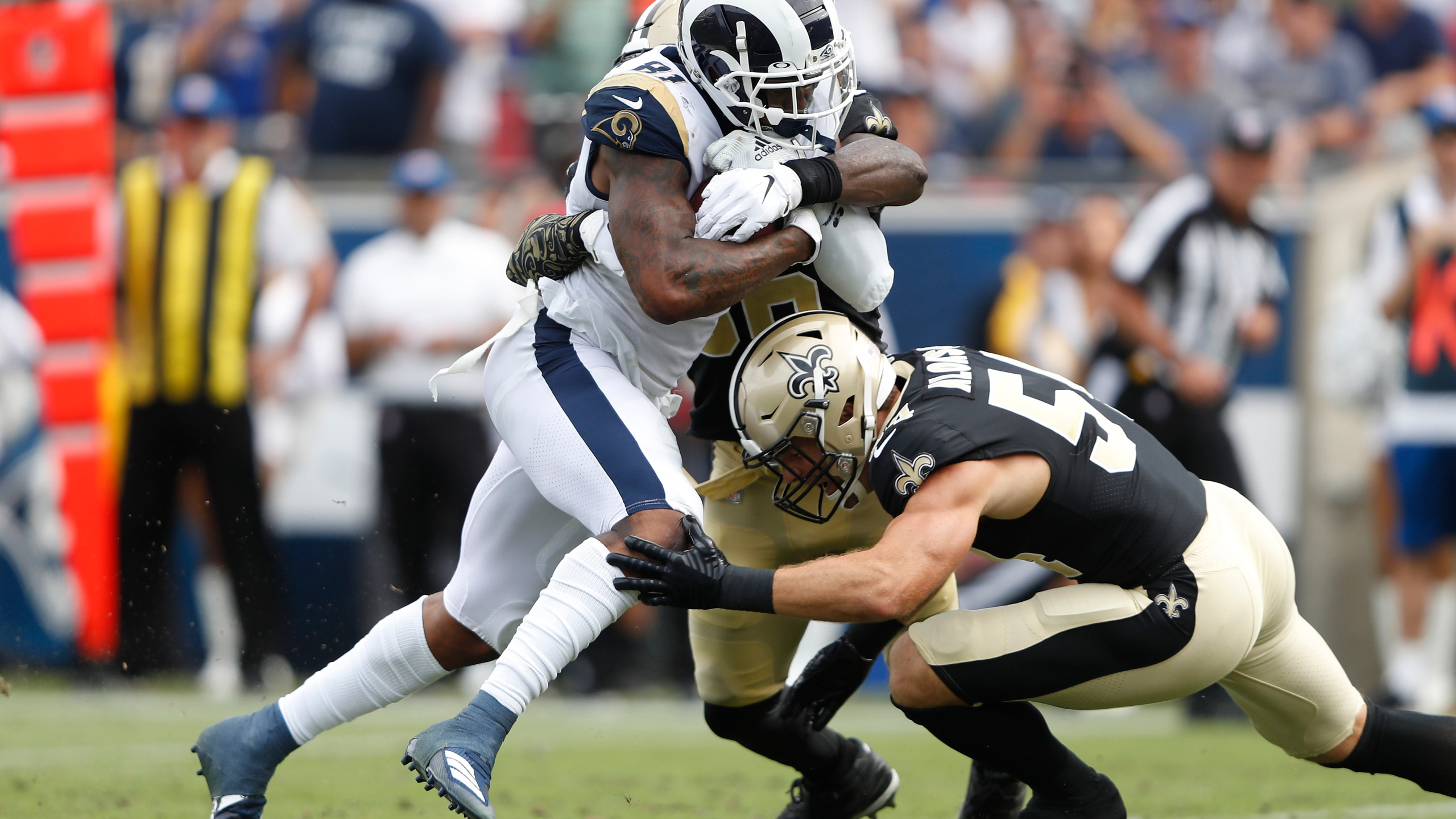 Gerald Everett #81 of the Los Angeles Rams is tackled by Kiko Alonso #54 and Demario Davis #56 of the New Orleans Saints during the second half in the game at Los Angeles Memorial Coliseum on Sep. 15, 2019 in Los Angeles, California. (Credit: Sean M. Haffey/Getty Images)