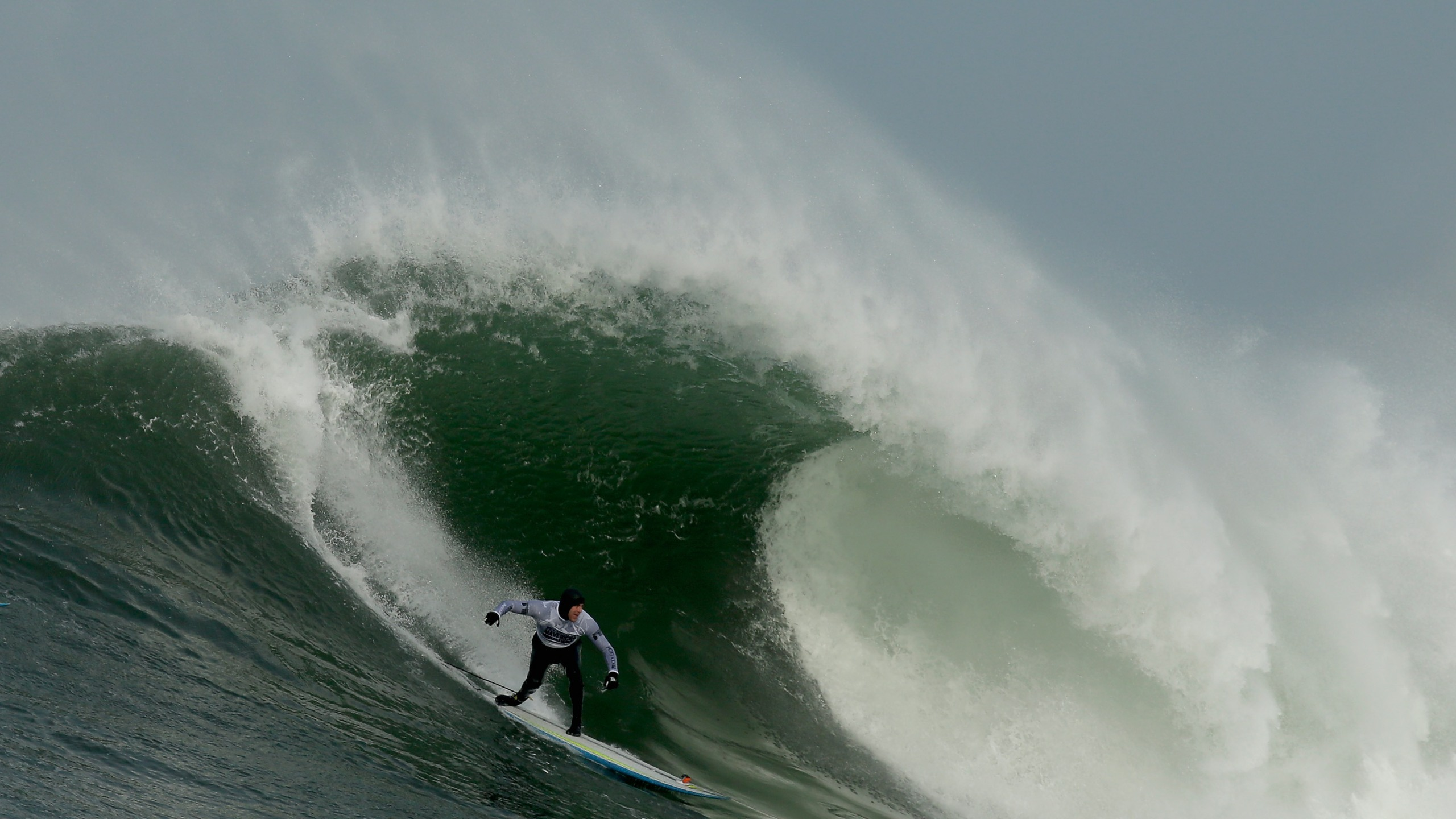 Grant Washburn rides a wave during the second heat of round one of Mavericks Invitational on January 24, 2014 in Half Moon Bay, California. (Credit: Ezra Shaw/Getty Images)